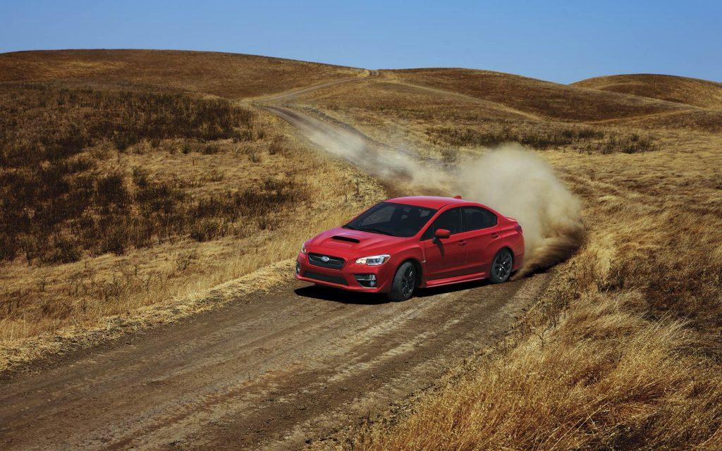Red 2016 Subaru WRX Speeding Through Dirt